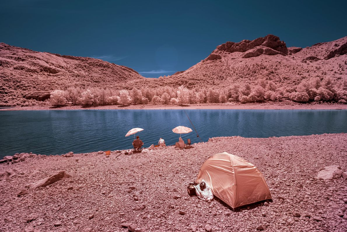 Gorg Blau, an artificial water reservoir, draws visitors who want to camp and fish without the ...