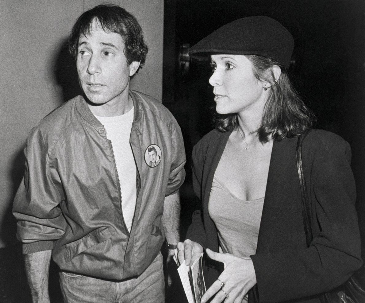 Carrie Fisher y su marido Paul Simon