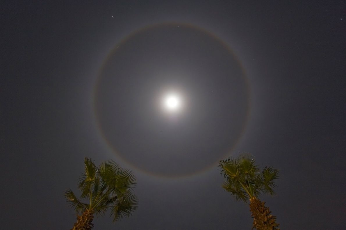 A ring around the moon is called a lunar halo. The rings are an optical illusion ...
