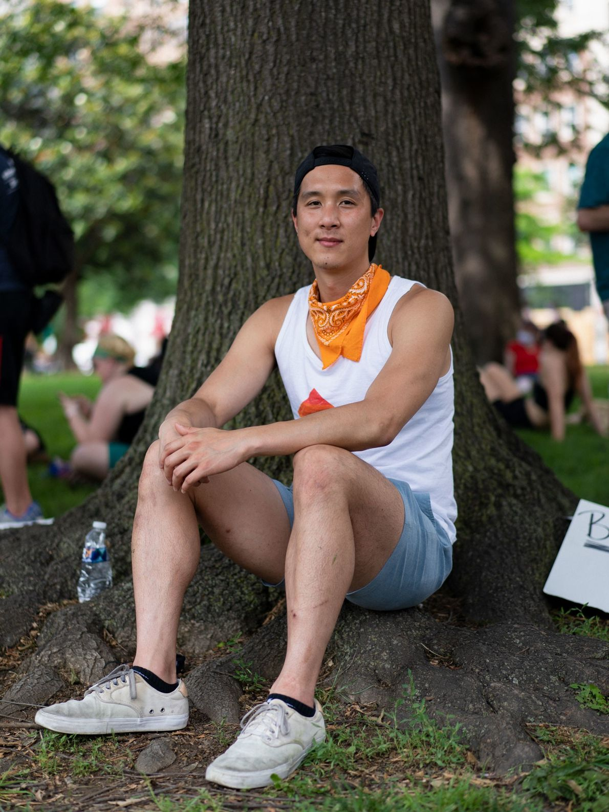 Clem Ayeung, 33, from Minnesota and now living in Washington, D.C., volunteers at a sign-making station. ...