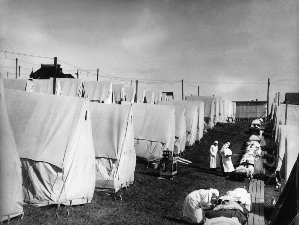 Under siege by the Spanish flu epidemic of 1918, nurses in Lawrence, Massachusetts, treat patients in ...