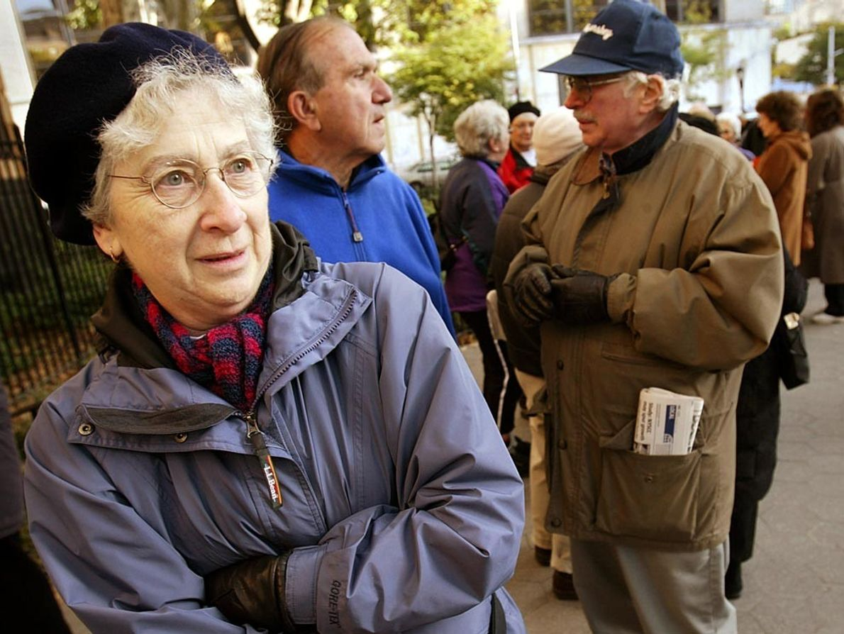 Bundled up against the chill of autumn 2004, 69-year-old Ruby Vogelfanger waits in line outside New ...