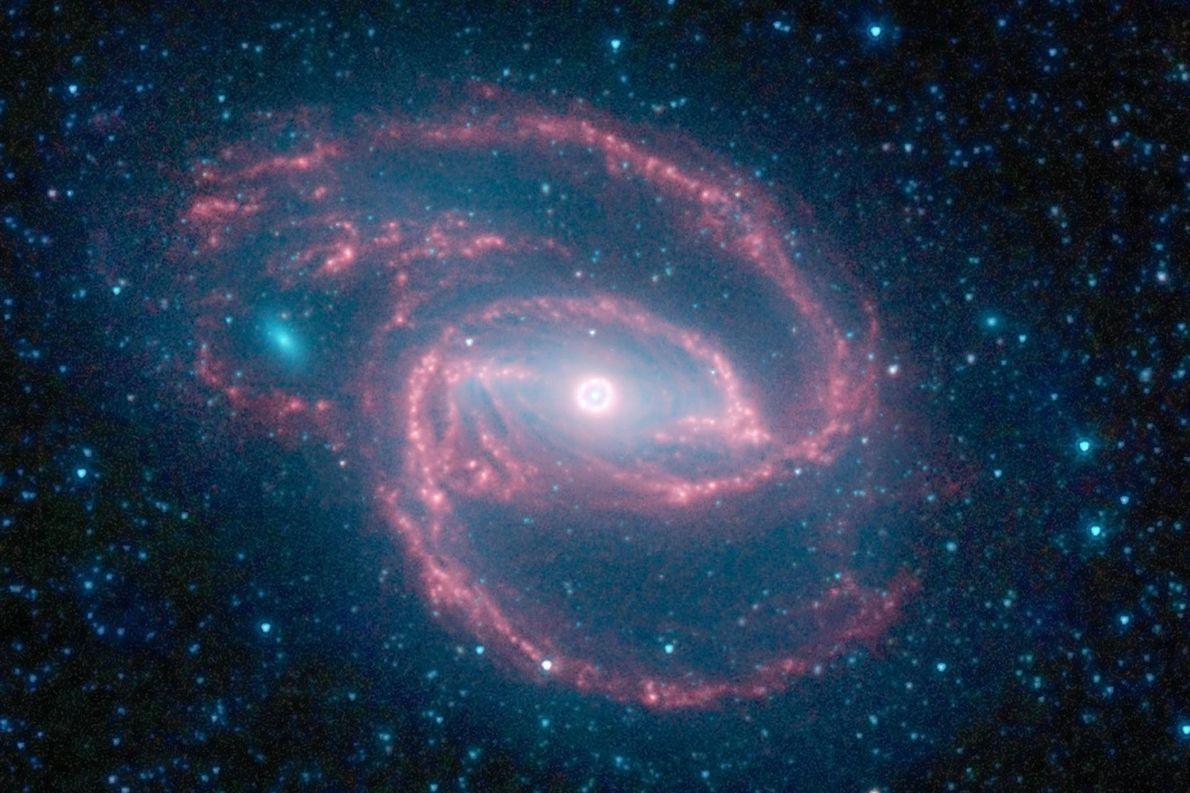 Una galaxia distante explorada por un telescopio de la NASA presenta un anillo de estrellas en …