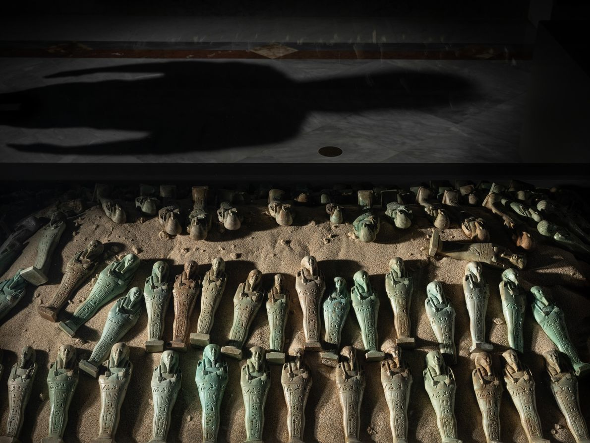 A weath of ancient Egyptian shabti, figurines meant to help their owner in the afterlife, repose ...