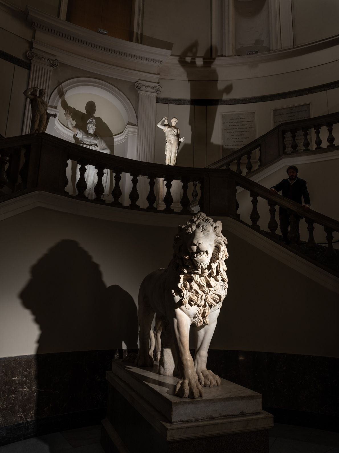 A Roman-era statue of a lion greets visitors at the main stairway of the National Archaeological ...