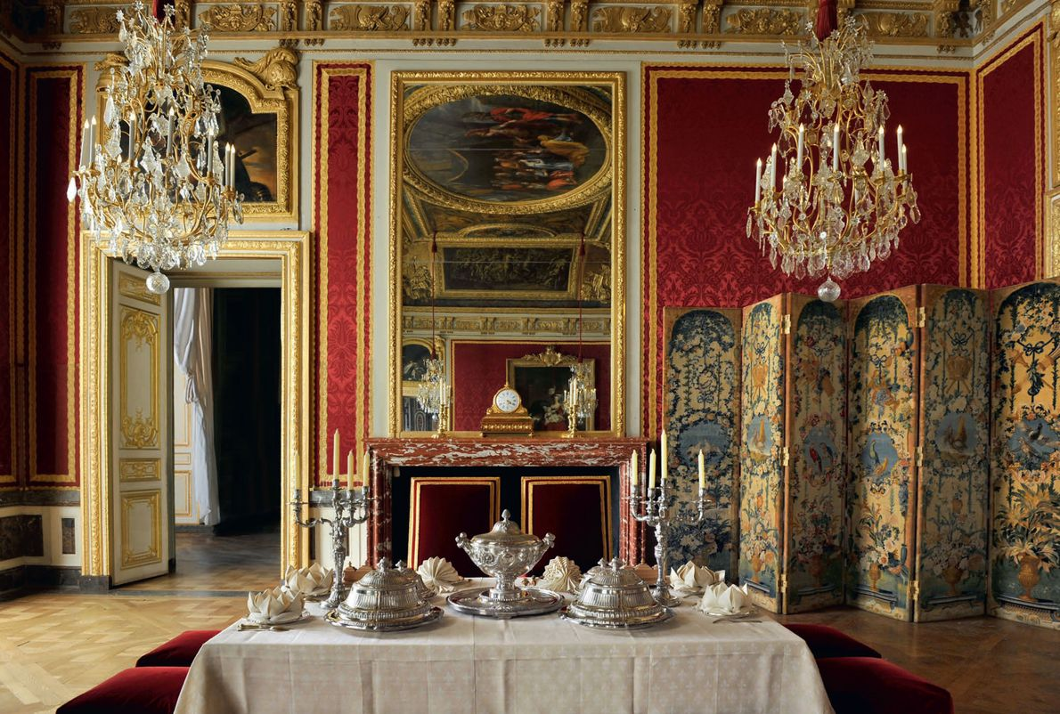 Louis XIV and his family ceremoniously dined in this room every evening at 10 p.m. while ...