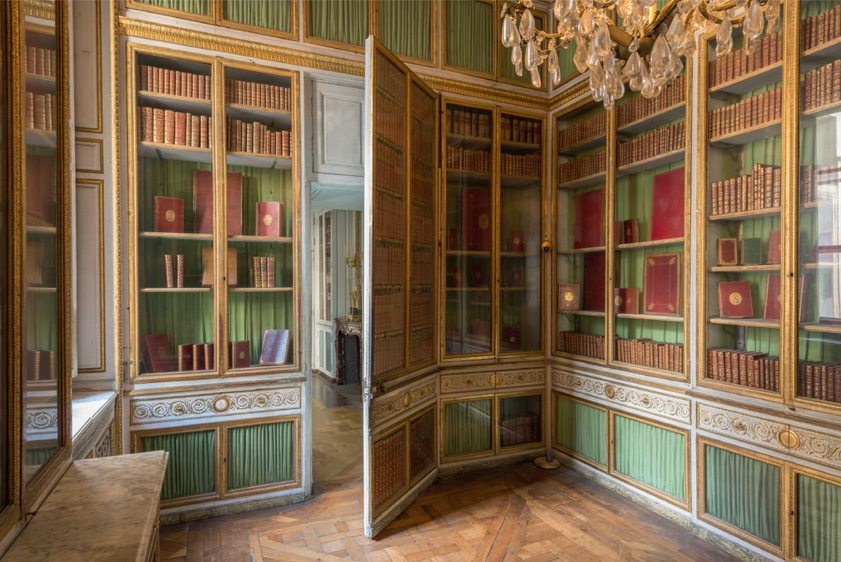 The intricately designed decor of the Queen's Library in shades of green and yellow gold displayed ...