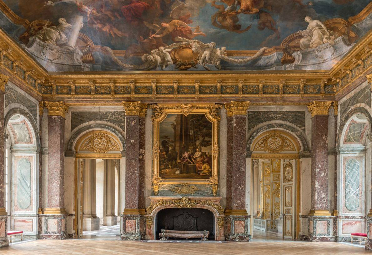 The largest of all salons in the palace, the Hercules Salon paneled in red and green ...