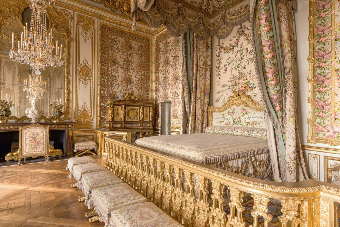 The Queen's Bedchamber has been restored to appear as it did when Marie Antoinette fled Versailles ...